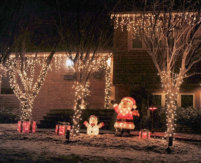 This Roslyn home with a welcoming Santa and Frosty the Snowman is at 20 Elm St.