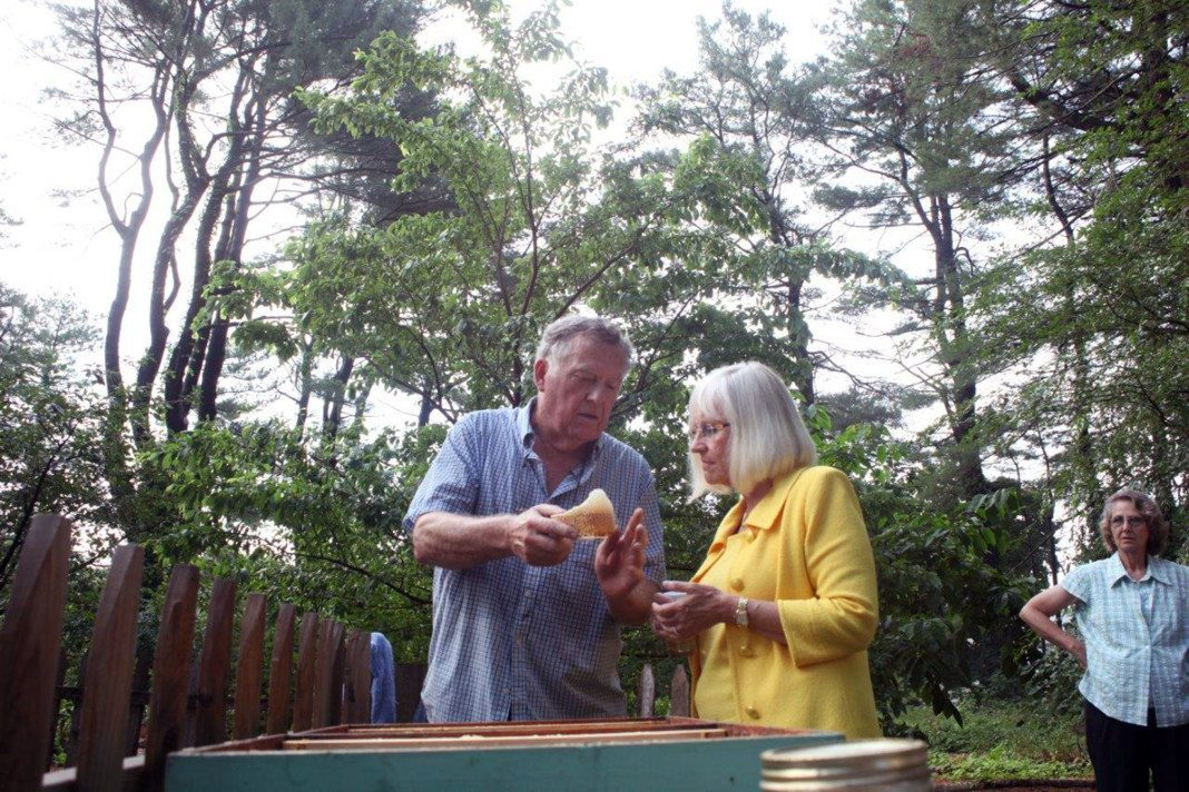 Richard Cogan And Judi Bosworth Hold A Piece Of A Honeycomb At Clark  Botanic Garden.