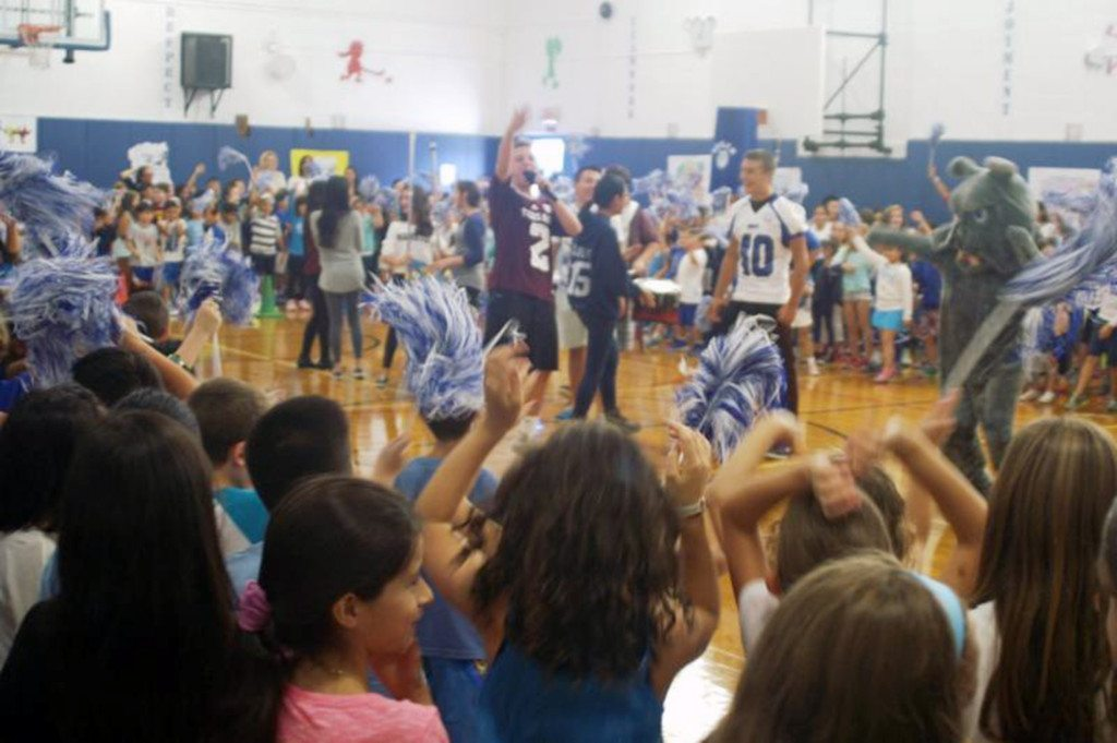 Leading the cheers at the pep rally