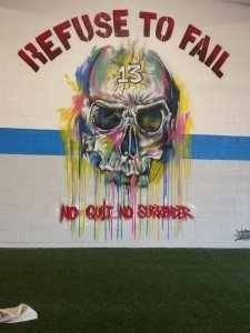 Murals of encouragement line the walls at Siege Athletics. Photo courtesy of Siege Fitness Facebook