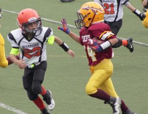 James Rosellon (right) during his own touchdown run
