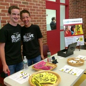 Ethan Lipetz, right, and his friend, Josh Bloom, at Roslyn Middle School Glove It sale at Back To School Night.