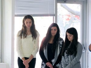 Caroline Crimmins, Hallie ArbitalJacoby and Ariana Arralde mourn the death of Emily Webb during an Our Town rehearsal.