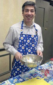 Rabbi Todd Chizner stirring up  latke batter