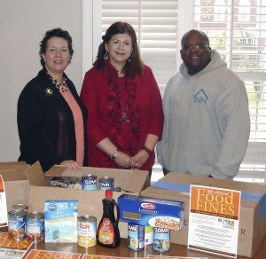 From left: Ellen Broder, Joan Casson Sauer of the Bryant Library  and Kevin Fournilier, donations  coordinator for The INN