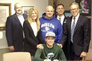 Pictured standing behind Jeremy  Kaplan are Roslyn High School  Principal Andrew Scott, Jeremy's mother Elayna Kaplan, Michael Corcoran, Athletic Director Peter Melore, and Jeremy's father, David Kaplan.