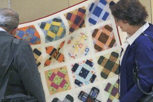 Attendees view a Mother's Dream Quilt