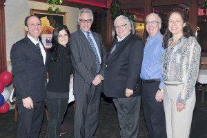 Michael Koblenz, third from right, congratulates fellow East Hills board members