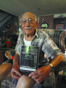 Guild cofounder and Levittown  resident Joe Pantatello showing off his short story anthology Robertson's Attic.