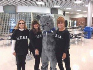 From left: representing the Roslyn Educational Secretaries Association (RESA), Susan Doyle, Rebecca Eger and Andrea Rubin came out to participate in Roslyn High School's Homecoming celebration on Saturday, Sept. 24.