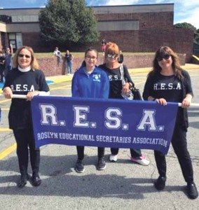 RESA members lining up before the parade through town with Roslyn High School freshman Olivia Viruet-Quintero, who came to lend her support. RESA is comprised of administrative assistants, clerk typists, secretaries and many other positions within the Roslyn School District that support the administration, faculty, staff, students and parents.